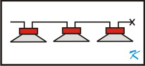Wired as Class B or Class A, fire alarm speakers are a distributed sound system. The only difference between fire alarm and distributed sound speakers is the DC current blocking capacitor inside the fire alarm speaker.